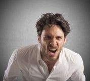 Gritos irritados do homem de negócios Foto de Stock
