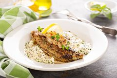 Grits with fried fish and shrimp. Grits with fried catfish and shrimp, southern breakfast concept royalty free stock photography