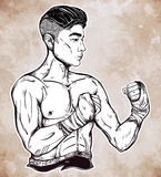 Gritty Asian boxer or Muay Thai martial artist. Royalty Free Stock Photo