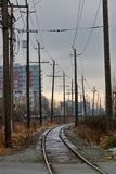 Gritty City in Early Morning. Vertical view of cold, gritty rail track winding through a city in the early morning hours Royalty Free Stock Photography
