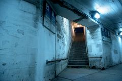 Gritty dark Chicago city stairway at night. Royalty Free Stock Photography