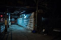 Gritty dark Chicago city street at night. Royalty Free Stock Photo