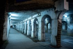 Gritty dark Chicago city street at night. Royalty Free Stock Image