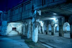 Gritty dark Chicago city street at night. Royalty Free Stock Photo