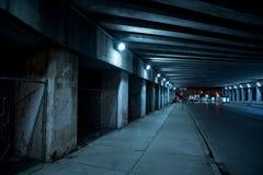 Gritty dark Chicago city street at night.