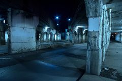 Gritty dark Chicago city street at night. Royalty Free Stock Photos