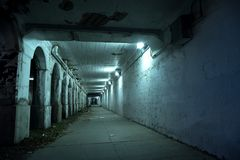 Gritty dark Chicago city street tunnel at night. Royalty Free Stock Photography