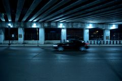 Gritty dark Chicago highway bridge at night. Royalty Free Stock Photography