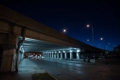 Gritty dark Chicago highway bridge at night. Royalty Free Stock Image
