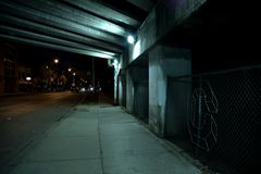 Gritty dark Chicago highway bridge underpass at night. Gritty dark Chicago highway bridge underpass with traffic at night Stock Photos