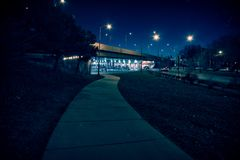 Gritty dark Chicago highway bridge underpass at night. Gritty dark Chicago highway bridge underpass with traffic at night Royalty Free Stock Image