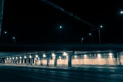 Gritty dark city highway bridge at night Stock Images