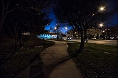 Gritty dark night scene with sidewalk at night in Chicago. Gritty dark night scene with sidewalk, highway bridge and traffic in Chicago Royalty Free Stock Photography