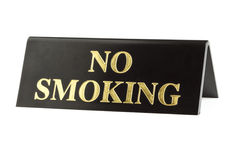 Gritty no smoking sign. Gritty old no smoking sign with golden letters isolated on white Royalty Free Stock Photos