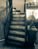 Gritty old image stairway leading up  from hall Royalty Free Stock Photo