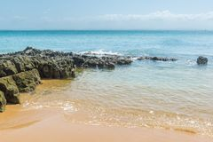 Gritty rocks by the shoreline with small  pools. Gritty rocks by the shoreline with small salt water pools Royalty Free Stock Images