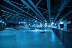 Gritty and scary city skate park at night in Chicago. Royalty Free Stock Images