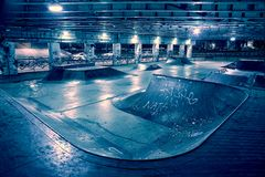 Gritty and scary city skate park at night. Stock Photos