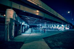Gritty and scary city skate park at night in urban Chicago. Royalty Free Stock Photos