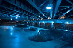 Gritty and scary city skate park at night in urban Chicago. Gritty and scary city skate park in urban Chicago at night Stock Image