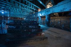 Gritty and scary city skate park at night in urban Chicago. Gritty and scary city skate park in urban Chicago at night Royalty Free Stock Photo