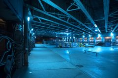 Gritty and scary city skate park at night in urban Chicago. Royalty Free Stock Images