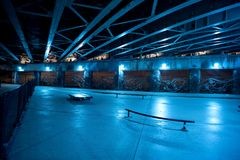 Gritty and scary city skate park at night in urban Chicago. Royalty Free Stock Photo