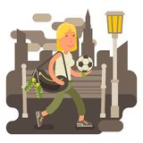 Gritty woman going to soccer training. Determined and strong woman with sports bag and ball going to the football training Stock Photo