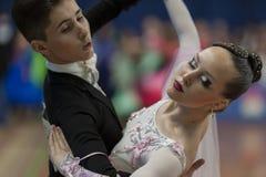 Grivachevskiy Stepan and Sergeichuk Anastasiya Perform Juvenile-2 Latin-American Program on National Championship Royalty Free Stock Photo