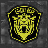 Grizzly bear head, vector emblem. Royalty Free Stock Images