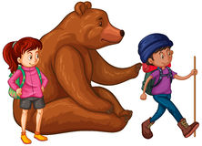 Grizzly bear and two hikers Stock Image