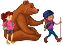 Grizzly en twee wandelaars Stock Afbeelding