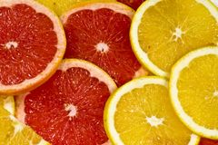Of Grjepfrut. The Beautiful background from slices an orange and a grapefruit Stock Photos