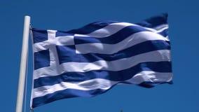 Grka chor?gwiany falowanie w wiatrze przeciw jasnemu niebieskiemu niebu Grek flaga W Jaskrawym ?wietle s?onecznym zbiory
