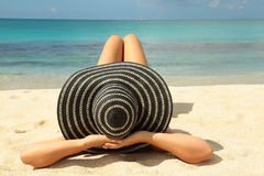 Grl with blue hat sunbathing Royalty Free Stock Photos