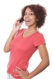 Grl che comunica sul telefono delle cellule Immagine Stock