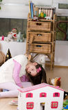 Grl playing with dolls house Stock Photo