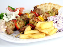 Grlled meat food. Grilled Meat Skewers with salad and potatoes Stock Photo