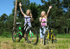 Grls on a bicycle Royalty Free Stock Images