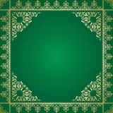 Grön bakgrund med den guld- prydnaden för tappning Arkivfoton