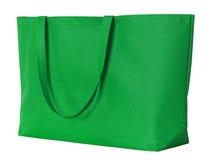 Grön shoppingpåse som isoleras på vit Royaltyfri Bild