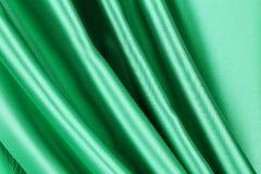 grön silk för gardin Arkivfoton