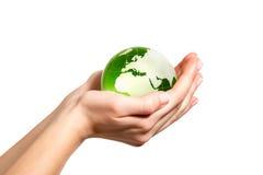 Grön värld i hand Arkivfoto