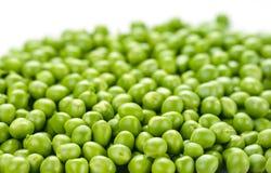 Gröna ärtor. Matbakgrund. Royaltyfri Bild