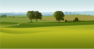Grüne Landschaft mit Bäumen Lizenzfreie Stockfotografie