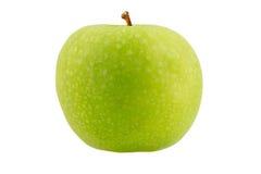 Grüner Apfel mit an einem weißen Hintergrund Stockbild