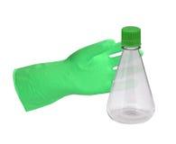 Grüner Handschuh und ein Reagenzglas Lizenzfreies Stockfoto