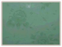 Grüner mit Blumenhintergrund auf gestrickter Art Stockfoto