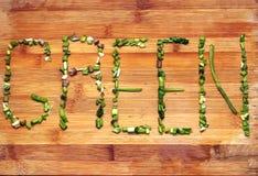 Grünes Wort durch Grüns Lizenzfreie Stockbilder