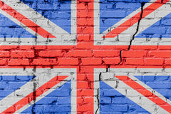 Großbritannien-Flagge gemalt auf einer Backsteinmauer Markierungsfahne von Vereinigtem Königreich Strukturierter abstrakter Hinte lizenzfreie stockfotografie